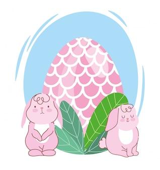 Feliz páscoa coelhos cor de rosa fofos com decoração de folhagem de ovo