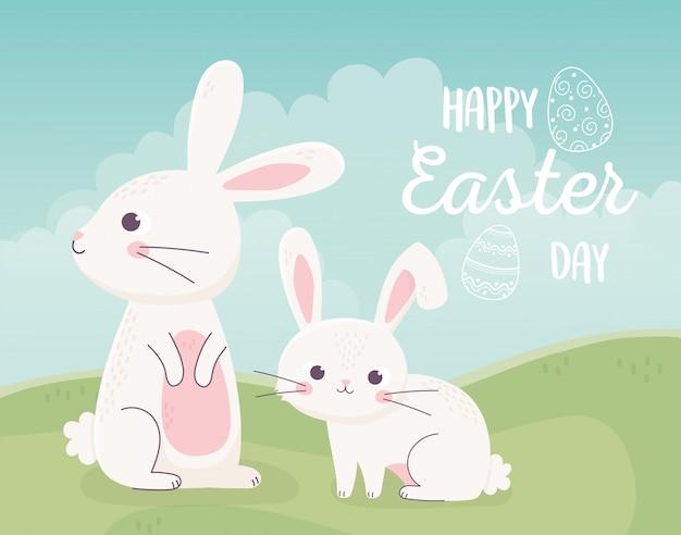 Feliz páscoa, coelhos pequenos bonitos no cartão da natureza do campo