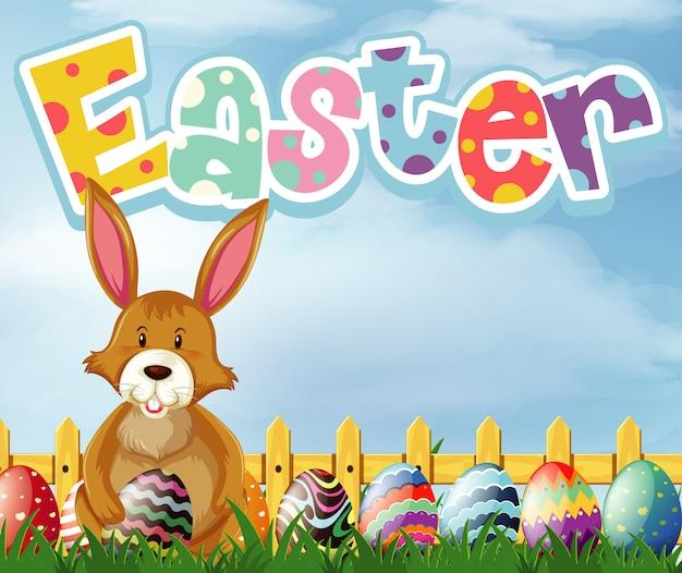 Feliz páscoa design de fonte com coelho e ovos no jardim