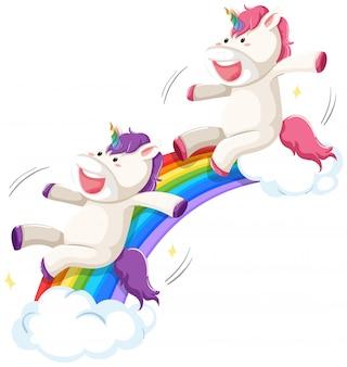 Feliz unicórnio no slide de arco-íris
