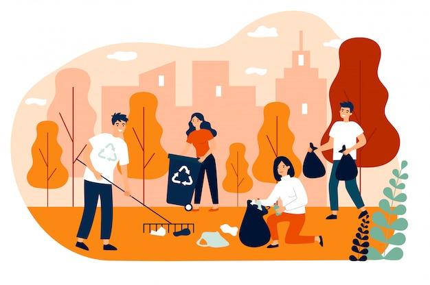 Felizes voluntários coletando lixo no parque da cidade
