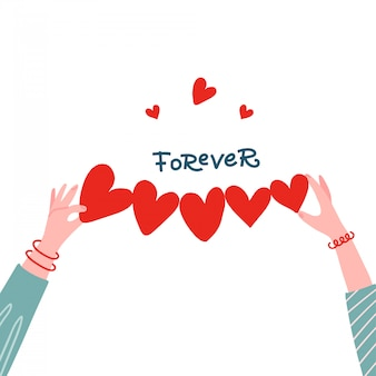 Femininas mãos segurando uma forma de papel de coração linha para o conceito de saudação.