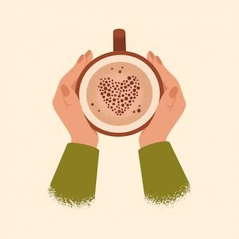Femininas mãos segurando uma xícara de café