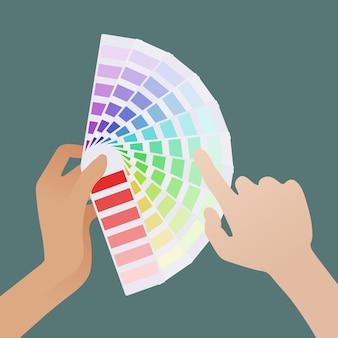 Feminino mão segurando o guia de cores e mão masculina pálida escolhe a sombra