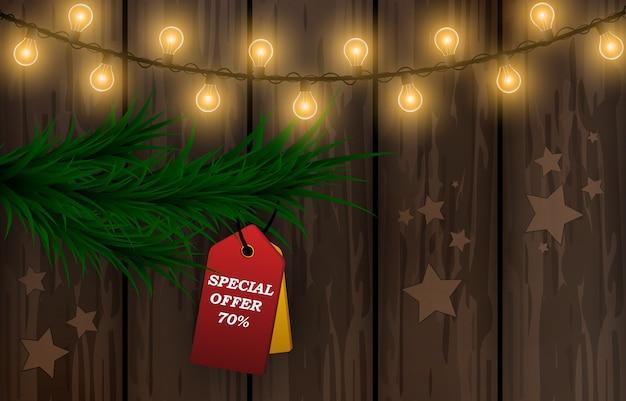 Feriado de natal. oferta especial. descontos de natal. garland, superfície de madeira, abeto.