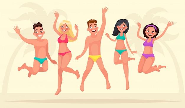 Férias de verão. feliz grupo de jovens estão saltando no fundo de uma praia tropical.