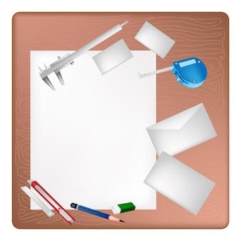 Ferramentas de arquiteto, deitado em uma página em branco e envelope