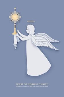 Festa de corpus christi com anjo em camadas de papel segurando uma custódia