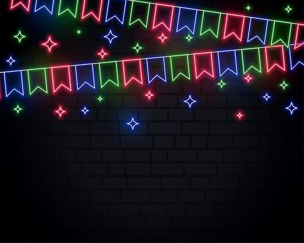 Festão de néon com estrelas no fundo de tijolo