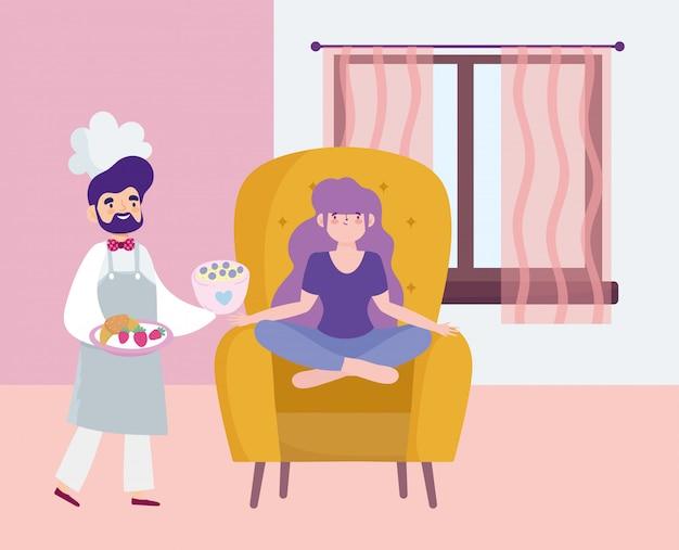 Ficar em casa, chef masculino com comida nas mãos e garota sentada na cadeira dos desenhos animados,