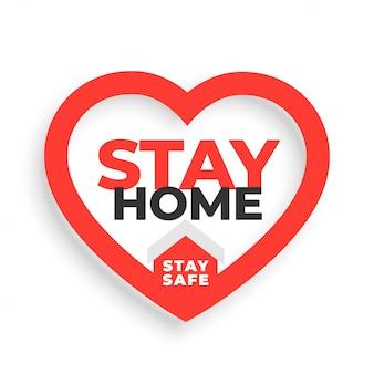 Ficar em casa e ficar em segurança slogan com coração