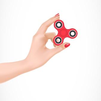 Fidget spinner na ilustração do braço feminino