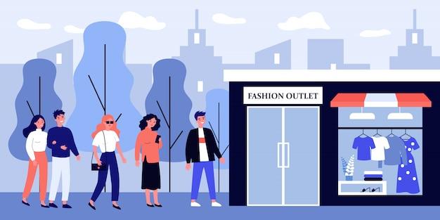 Fila de pessoas à espera de abertura de tomada de moda