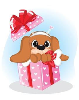 Filhote de cachorro adorável em uma caixa de presente com uma fita vermelha
