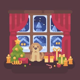 Filhote de cachorro bonito sentado à janela