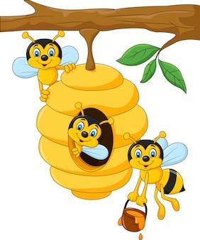 Filial de uma árvore com uma colméia e abelhas