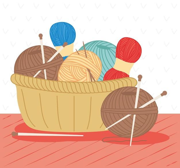 Fios de tricô e fios com agulhas na cesta na mesa
