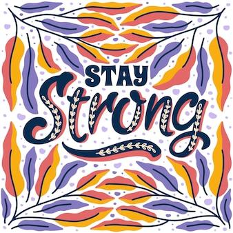 Fique com citações positivas desenhadas à mão emolduradas em um fundo colorido de folhagem