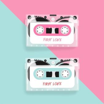 Fita cassete vintage na superfície rosa e azul pastel.