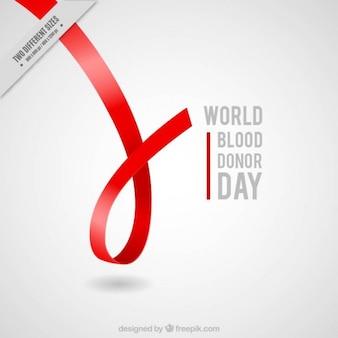 Fita vermelha doador de sangue fundo do dia
