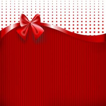 Fita vermelha e arco em fundo de textura de papel vermelho