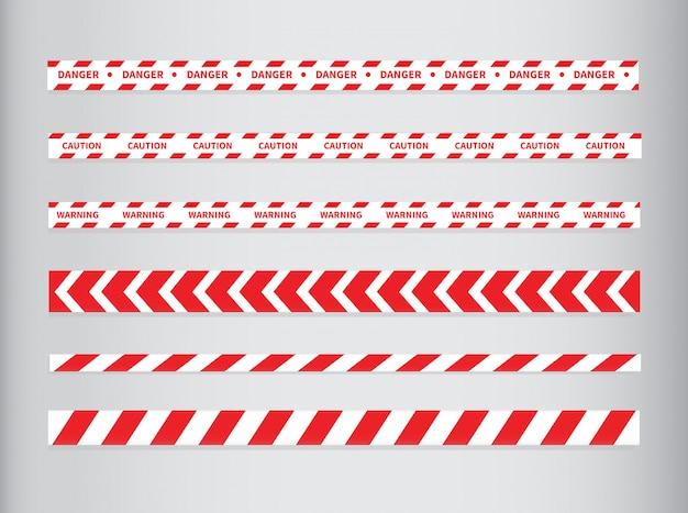 Fitas de cuidado e perigo. fita de advertência. linha vermelha e branca listrada.