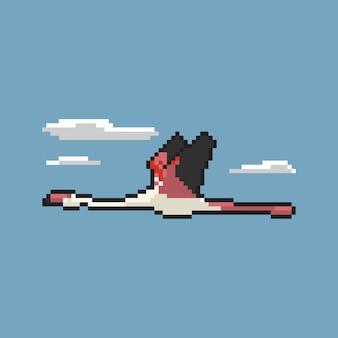 Flamingo voador na arte de pixel do céu