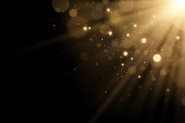 Flash de luz dourada com brilhos bokeh com brilhos em um fundo preto. raios de luz.