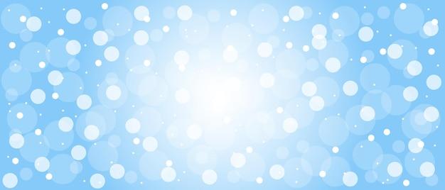 Floco de neve no céu pontos de luz de brilho mágico no fundo azul