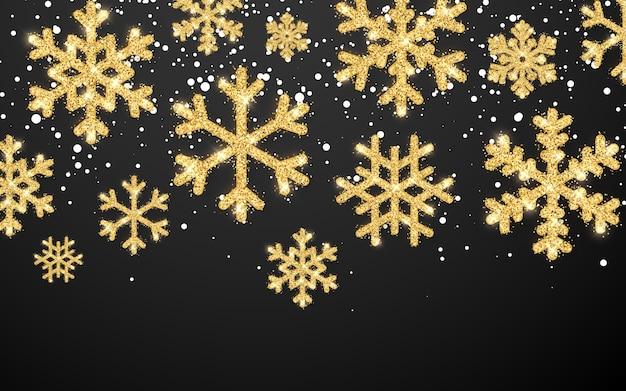 Flocos de neve brilhantes de ouro sobre fundo preto. plano de fundo natal e ano novo.