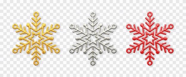Flocos de neve cintilantes de ouro, prata e vermelhos com textura de glitter isolada em transparente.