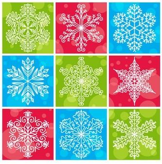 Flocos de neve com coleção colorida do vetor de fundo natal