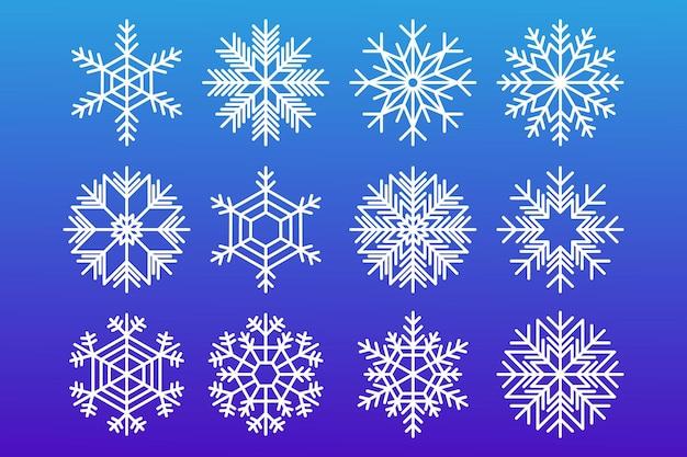 Flocos de neve. conjunto de inverno ano novo e flocos de neve de natal de cor branca sobre um fundo azul.