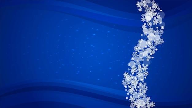 Flocos de neve de inverno em fundo azul com brilhos.