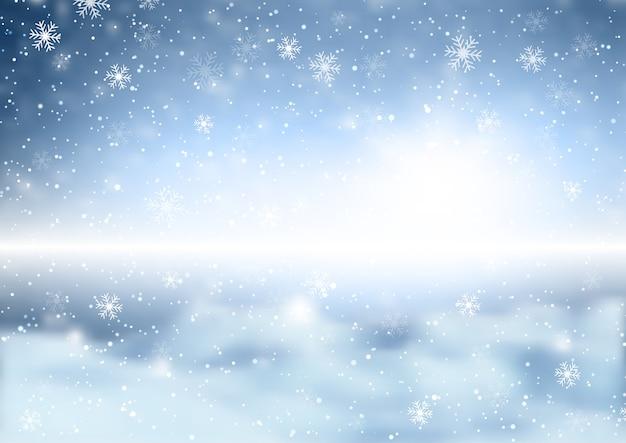 Flocos de neve de natal em um fundo desfocado de paisagem de inverno
