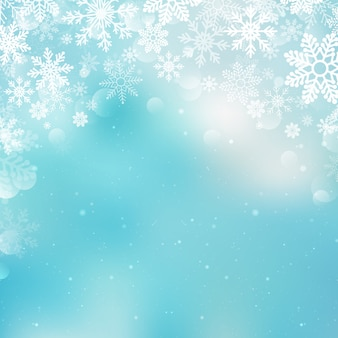 Flocos de neve de natal fundo desfocado
