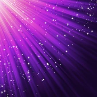Flocos de neve e estrelas descendo na luz.