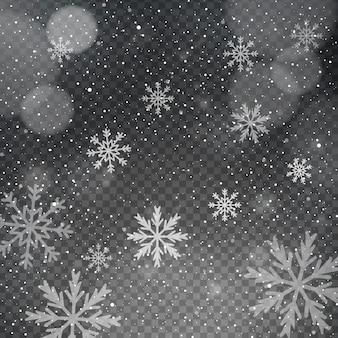 Flocos de neve em um fundo transparente bokeh