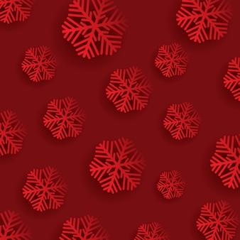 Flocos de neve em um fundo vermelho