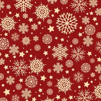 Flocos de neve em um padrão de fundo vermelho