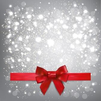 Flocos de neve lindos de natal e fita vermelha