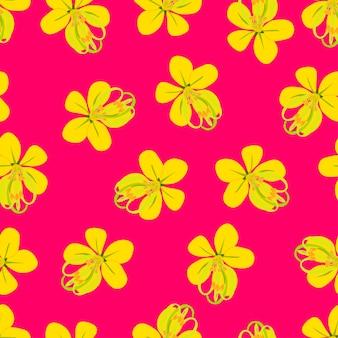 Flor de chuva dourada em fundo rosa