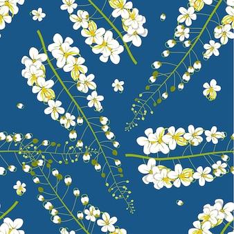 Flor de chuva dourada sobre fundo azul índigo
