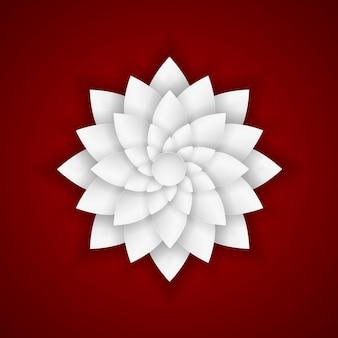 Flor de papel em fundo vermelho.