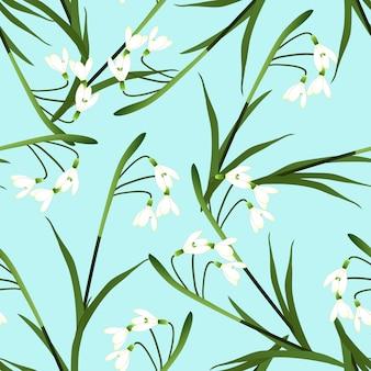 Flor snowdrop branco sobre fundo azul claro
