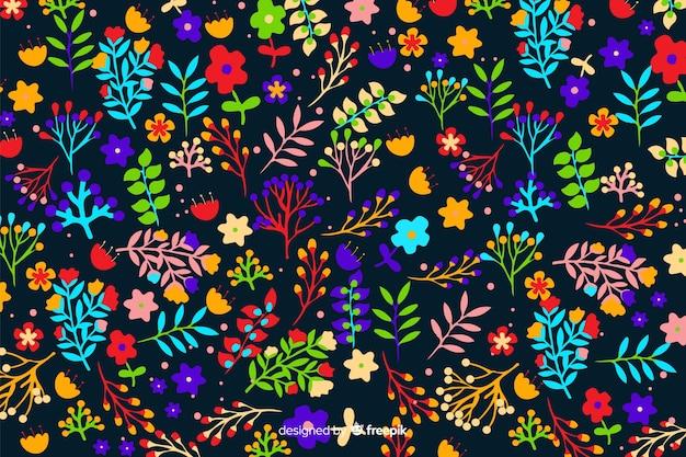 Flores coloridas decorativas e fundo de folhas