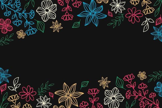 Flores coloridas em fundo de quadro-negro