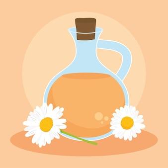 Flores de camomila com jarro de chá