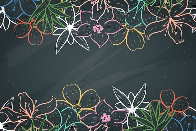 Flores desenhadas à mão sobre fundo de quadro-negro