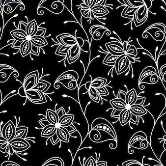 Flores do campo. padrão sem emenda de cores decorativas com um contorno branco sobre um fundo preto.